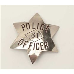 "Old stock 6-point badge marked ""Police  Officer 31""; no hallmarks on reverse.      Est.:  $75-$125."