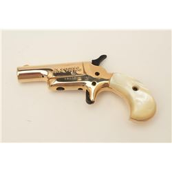Butler blackpowder single shot derringer, .31  caliber, gold finish, faux pearl grips, S/N  B81764,