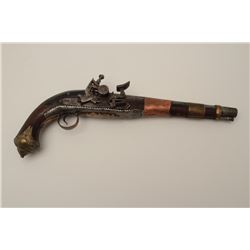 "Mid-eastern flintlock pistol, approximately  15"" overall with brass and copper mountings,  wood stoc"