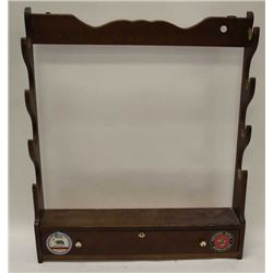 Lot of five sportsman racks.  The lot  includes four wooded rifle racks for wall  mounting.  Three a