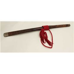 "Southeast Asian Da with scabbard,  approximately 28"" overall with red cord  hanger.      Est.:  $75-"