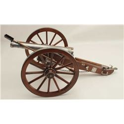 "Finely constructed display cannon and wood  carriage, approximately 28"" long by 16"" wide  by 12"" in"
