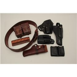 Misc. lot of 7 pieces, 6 leather and 1  plastic holster, clip holster, belt,  cartridge holder and e