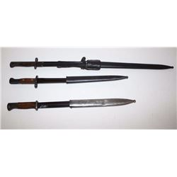):  Lot of 3 foreign bayonets, each with  sheaths, one with leather frog.     Est.:    $100-$200.