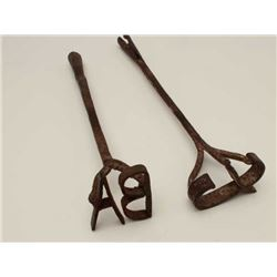 Lot of two short handle branding irons; great  decorators.     Est.:  $35-$70.