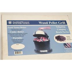 Smith & Wesson Model SWS022 wood pellet  smoker, like new in factory box.      Est.:   $25-$50.