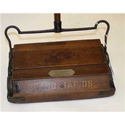 "Antique wood and iron mounted floor sweeper  marked ""BISSELL'S/GRAND RAPIDS"" with metal  plate ""WEBB"