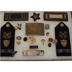 Riker case of misc. U.S. military uniform  boards, pins, belt buckle, etc.; a great  little grouping