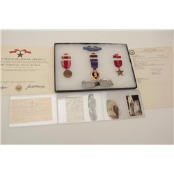 Riker case and documents for Bruce Lowden  including dog tags, Bronze Star and Purple  Heart (WW II)