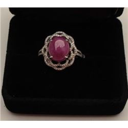One exquisite 18k white gold ladies ring set  with a 5ct Burmese ruby cabochon weighing  approx 5ct