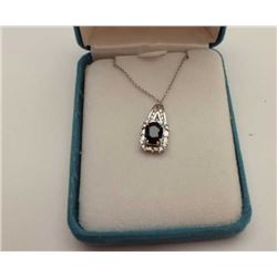One 2 ct blue sapphire pendant made in 14k  white gold set with  round diamonds and   tapered baguet