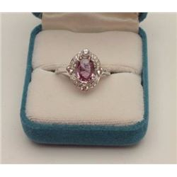 One ladies ring in 18k white gold set with an  oval pink sapphire weighing 2.0 ct and 0.50  ct of fi