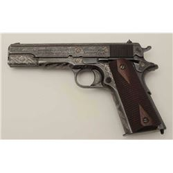 Colt Model 1911 .45 ACP Semi-Auto pistol,  fully engraved and inscribed, S/N C12885. The  left front