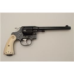 """Colt New Service Double Action revolver in  .38-40 Winchester caliber with a 7 ½"""" barrel,  fully and"""