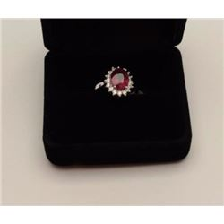 One 18k white gold  ladies ring set with a  fine oval ruby weighing approx 3ct and 0.25ct  of diamon