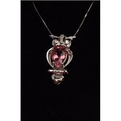 One 18k white gold owl shaped pendant set  with a 5ct Pink tourmaline and diamonds  Est:$750-1,000