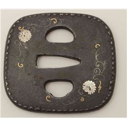 An attractive heavy iron tsuba inlaid with  silver chrysanthemums, silver and gold  highlights, pie