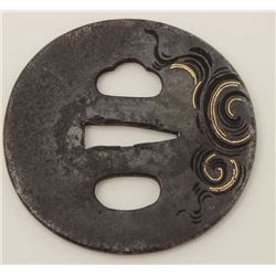 A good iron tsuba chiseled with a fierce  dragon in clouds inlaid with gold. 200-400  years old. EST
