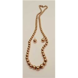 One 14k yellow gold bead necklace and  matching earstuds Weighing 28gms  Est:$1,000-1,100