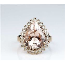 Incredible Morganite ring featuring a fine  Morganite weighing approx. 8.00-10.00 carats  and surrou
