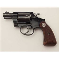 "Colt Cobra Model DA revolver, .38 Special  caliber, 2"" barrel, blued finish, checkered  wood medalli"
