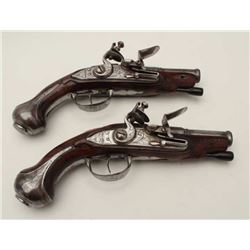 Pair of 18th century European flintlock  pocket pistols with cannon barrels. No  signature or proofs