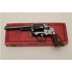 """Smith & Wesson K-22 """"Outdoorsman"""" double  action revolver with a 6"""" barrel in .22  caliber with blue"""