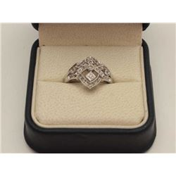 A beautiful antique style ladies 10 karat  white gold ring set with approximately 0.50  carats of di