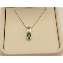Elegant 14 karat yellow gold ladies pendant  fine set with a fine, Columbian Emerald  weighing appro
