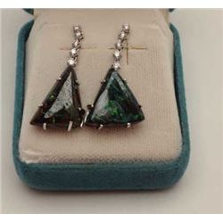 One pair of black opal earrings custom made  in 18k white gold suspended by a row of  diamonds .Est: