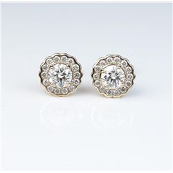 Very high quality ladies earrings with two  'IDEAL' cut diamonds weighing 0.75 carats of  F-G colors