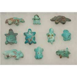 Riker case of approximately 10 old hand  carved turquoise stone effigies.     Est.:   $150-$300.
