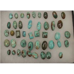 Riker case of approximately 44 old turquoise  cut stones for jewelry; variety of shapes,  sizes and
