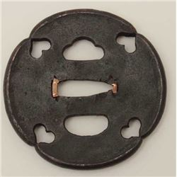 A good early iron tsuba finely pierced with  hearts. Fine patination. 200-400 years old.  EST:$200-$