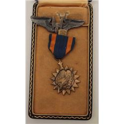 "Air Medal & case inscribed to Rueben Vigil  and numbered with a note ""Killed in USAF  plane crash 19"