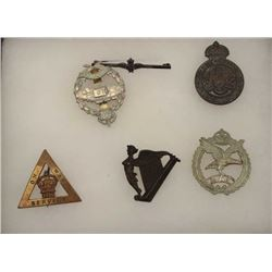 Riker case of approximately 6 British  military pins, circa WW I.     Est.:   $50-$100.