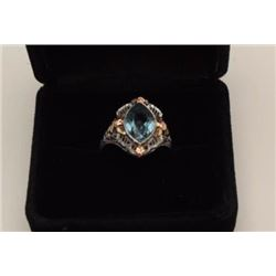 One 14k white gold ring with yellow accent  and set with a treated light blue sapphire  Est:$300-400