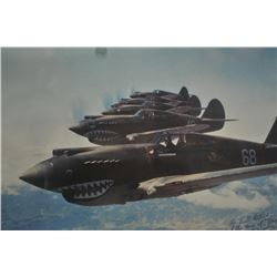World War II print of The Flying Tigers.  The  framed and matted print depicts a flight of  P-40C To