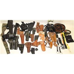 Large lot of holster.    Est.:  $100-$300.