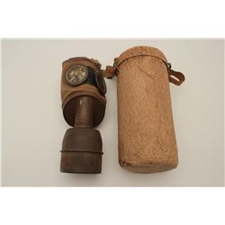 "Gas mask and case marked on the bottom of the  can ""C.P. 1935M"" complete showing sun and  heat aged."