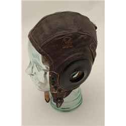"Aviator's leather helmet marked on outside  and inside ""Army Air Force"".      Est.:   $30-$60."