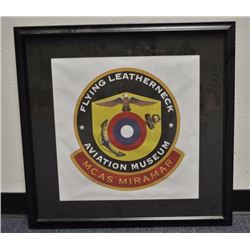 Lot of 4 framed aviation-related items  including a large framed insignia of the  Flying Leatherneck