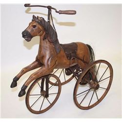"Reproduction of an old style child's tricycle  made as a prancing horse, approximately 24""  in heigh"