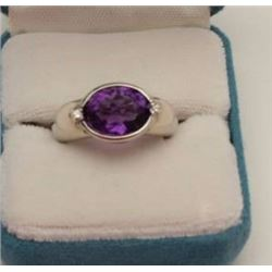 One modern ladies ring in 14k white gold  set  with a fine 3ct oval amethyst and 2 diamonds   Est:$5