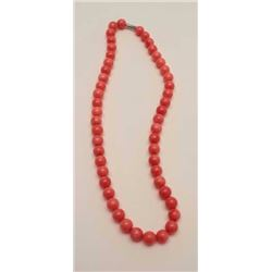 One perfectly matched rare salmon color round  coral bead necklace  Est:$500-600