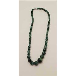 One graduated strand of Jade beads 18 inches  long and varying from 14mm to 7mm  eST:$600-750