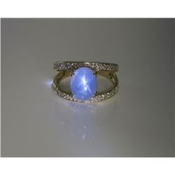 Stylish ladies ring set with a nice cabochon  Natural star sapphire weighing 6.74 carats  and accent
