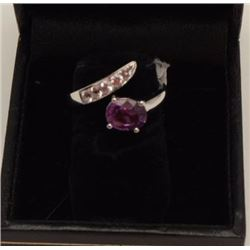 One unusual oval pink/lavender  sapphire ring  set in 18k white gold and enhanced with  5diamonds we