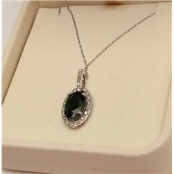 Majestic 10 karat white gold ladies pendant  set with a center oval green Tsavorite  weighing approx