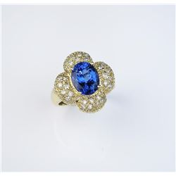 Gorgeous Tanzanite weighing approx. 4.50  carats and pave set with 28 round diamonds  weighing appro